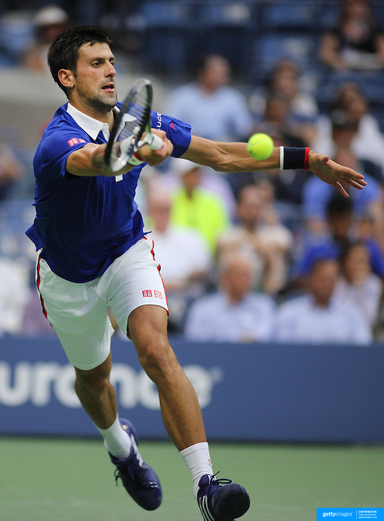 Novak Djokovic, Serbia, in action against Marin Cilic, Croatia, in the Men's Singles Semifinals during the US Open Tennis Tournament, Flushing, New York, USA. 11th September 2015. Photo Tim Clayton