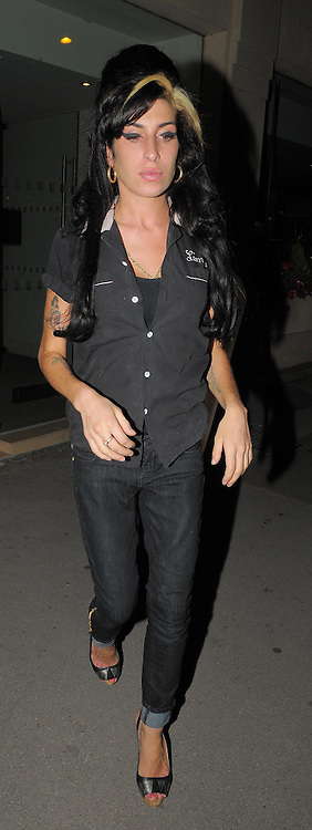 20.AUGUST.2009 - LONDON<br /> <br /> ERRATIC POP STAR AMY WINEHOUSE ARRIVING AT PREZO RESTAURANT IN COCKFOSTERS TO HAVE DINNER WITH SOME FIRENDS AND LEFT AT 10.30PM AFTER GIVING HER FRIEND A BIG HUG.<br /> <br /> BYLINE: EDBIMAGEARCHIVE.COM<br /> <br /> *THIS IMAGE IS STRICTLY FOR UK NEWSPAPERS & MAGAZINES ONLY*<br /> *FOR WORLDWIDE SALES & WEB USE PLEASE CONTACT EDBIMAGEARCHIVE - 0208 954 5968*