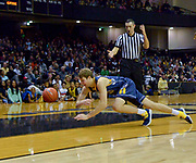 Kent State Golden Flashes guard Mitch Peterson (13) dives for the loose ball against the Vanderbilt Commodores during the second half of an NCAA basketball game in Nashville, Tenn., Friday, Nov. 23, 2018. Kent State won 77-75. (Jim Brown/Image of Sport)