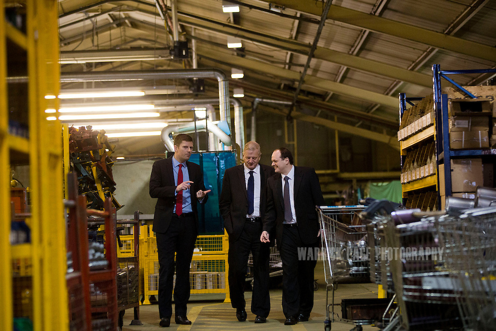 Shareholders, (L-R) John Massey (Chairman), Mark Blinston (Communications Director) and Toby Massey (Managing Director) walk through the BM Catalysts factory on February 6, 2013, in Mansfield, England. (Photo by Warrick Page)