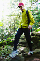 Blurred view of man hiking in a forest&#xA;<br />