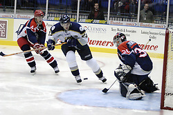 11 November 2006: Tyler Rennette steers the puck around Dale Lupul takes a shot on goal.&#xD;The Elmira Jackals met the Bloomington PrairieThunder at the U.S. Cellular Coliseum in Bloomington Illinois.<br />