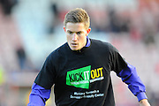 David Wheeler (11) of Exeter City  warming up wearing a Kick It Out T-Shirt before the EFL Sky Bet League 2 match between Exeter City and Luton Town at St James' Park, Exeter, England on 26 November 2016. Photo by Graham Hunt.