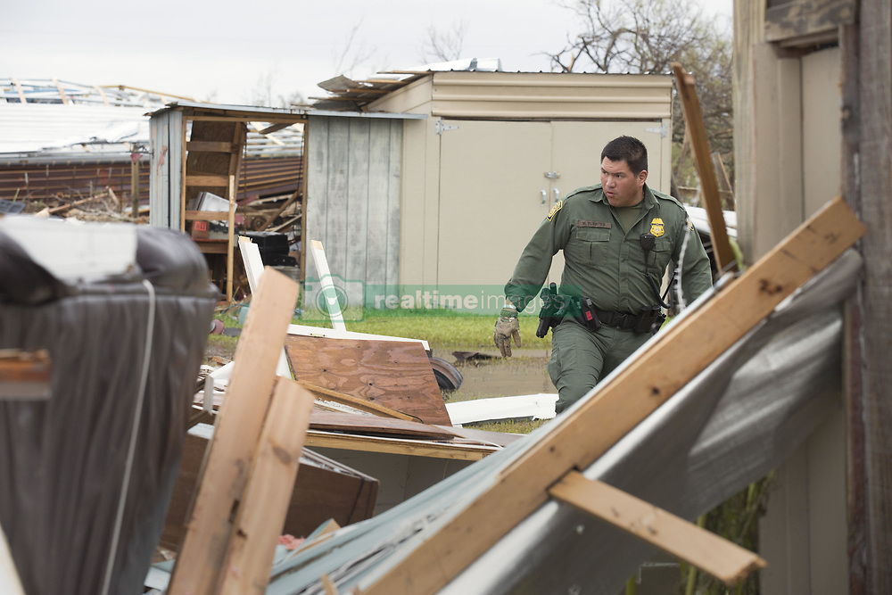 August 27, 2017 - Rockport, TX, United States - U.S Border Patrol agent Mario Fuentes searches for survivors among the rubble of a mobile home caused by Hurricane Harvey August 27, 2016 in Rockport, Texas. Tiny Rockport was nearly destroyed by Hurricane Harvey as it came ashore as a Category 4 storm with 130mph winds. (Credit Image: © Glenn Fawcett/Planet Pix via ZUMA Wire)