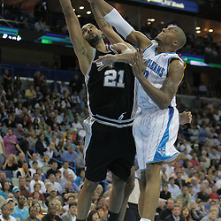 17 December 2008:  San Antonio Spurs forward Tim Duncan (21) shoots as New Orleans Hornets forward David West (30) defends during a 90-83 victory by the New Orleans Hornets over the San Antonio Spurs at the New Orleans Arena in New Orleans, LA..