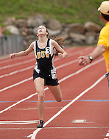 Emily Buck of Bow High School is spent as she crosses the finish line of the 1600 meter race during NHIAA Division III Track State Championships on Saturday.   (Karen Bobotas/for the Concord Monitor)