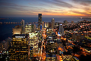 Aerial of downtown Miami, Florida at twilight with city lights glowing.