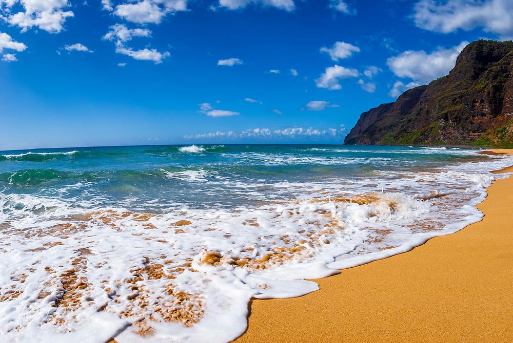 Surf and sand at Polihale Beach, Polihale State Park, Island of Kauai, Hawaii USA