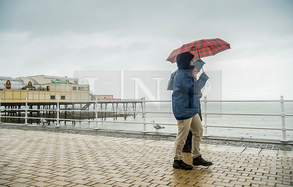 © Licensed to London News Pictures. 29/07/2018. Aberystwyth, UK. Wet and overcast Sunday at the seaside in Aberystwyth on the west Wales coast, as the long heatwave finally breaks down with thunderstorms and torrential rain over much of the country. photo credit:  Keith Morris/LNP