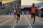 Emmanuel Wells (1678) of Washington State and Chris Jefferson (1089) of Sam Houston State run in a 100m heat during the NCAA West Track & Field Preliminary, Thursday, May 23, 2019, in Sacramento, Calif.