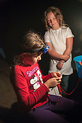 Molly demonstrates crocheting for a new friend Sharyn by lantern light at the Russell Pond Campground