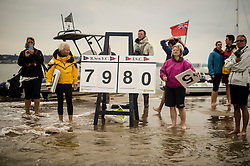 Score keepers during the annual Bramble Bank cricket match between the Royal Southern Yacht Club and the Island Sailing Club of Cowes, which takes place on a sandbank in the middle of the Solent.