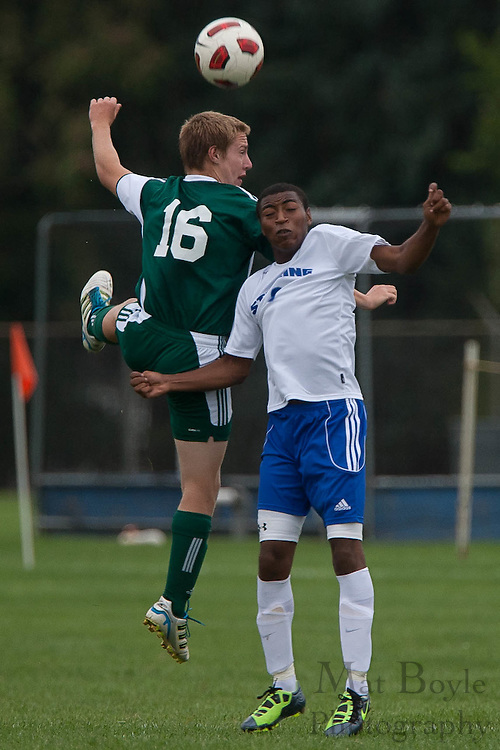 West Deptford's Dan Devine wins a head-ball over Sterling's Jordan Mosley during the first match of the season at Sterling High School on Thursday September 8, 2011.