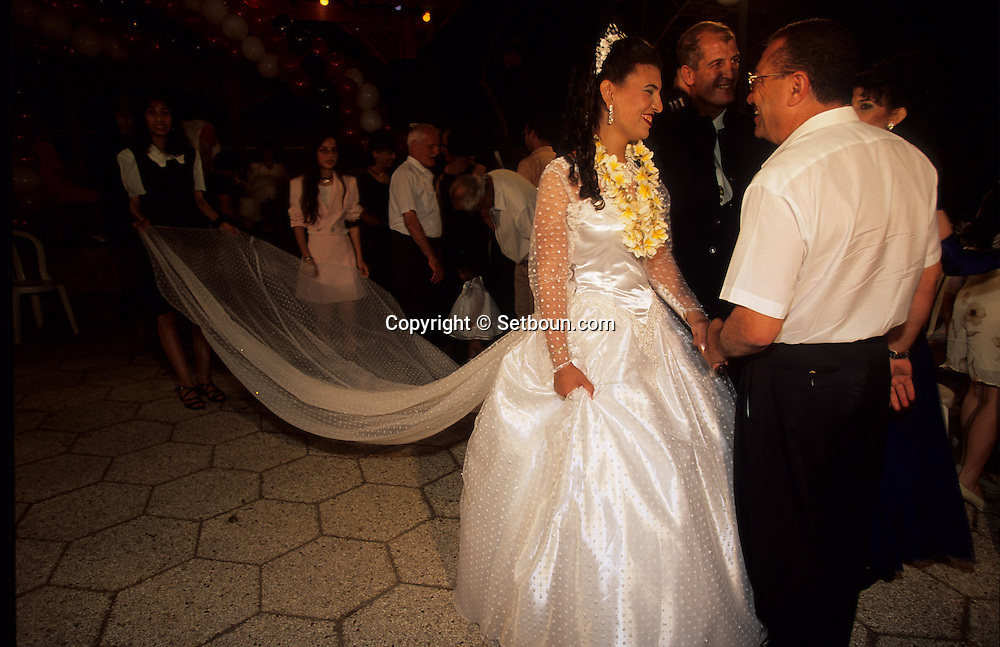 = The Samaritans: wedding in the synagogue of Holon (Tel Aviv).    Israel   the night before the wedding the bride is in red  +