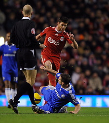Frank Lampard tackles Liverpool's Xabi Alonso which resulting in a red card during the Barclays Premier League match between Liverpool and Chelsea at Anfield on February 1, 2009 in Liverpool, England.
