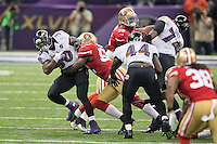 3 February 2013: Running back (30) Bernard Pierce of the Baltimore Ravens runs and is tackled by (52) Patrick Willis of the San Francisco 49ers during the first half of the Ravens 34-31 victory over the 49ers in Superbowl XLVII at the Mercedes-Benz Superdome in New Orleans, LA.