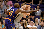 Oct 16, 2014; Phoenix, AZ, USA; San Antonio Spurs forward Matt Bonner (15) handles the ball against the Phoenix Suns forward Anthony Tolliver (40) in the first half at US Airways Center. Mandatory Credit: Jennifer Stewart-USA TODAY Sports