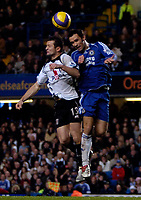 Photo: Ed Godden.<br />Chelsea v Fulham. The Barclays Premiership. 30/12/2006.<br />Fulham's Tomasz Radzinski (L), is met in the air by Ricardo Carvalho.