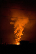 Smoke billows from a gas storage facility damaged by the  March 11 magnitude 9 quake in Sendai City, Miyagi Prefecture on 13 March, 2011.  Photographer: Robert Gilhooly
