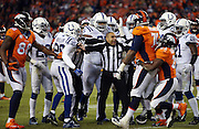 Side judge James Coleman (95) tries to break up a scuffle between Denver Broncos guard Orlando Franklin (74), who is held back by Denver Broncos running back C.J. Anderson (22), and Indianapolis Colts cornerback Darius Butler (20) after a third quarter Broncos pass reception by Denver Broncos wide receiver Demaryius Thomas (88) during the NFL week 19 AFC Divisional Playoff football game against the Indianapolis Colts on Sunday, Jan. 11, 2015 in Denver. The Colts won the game 24-13. ©Paul Anthony Spinelli