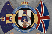 A Loyalist mural for the 'South Belfast Young Conquerors'  including an image of an ancient warrior armed with shield and sword plus the emblem of the UVF (Ulster Volunteer Force), on 7th June 1995, in Belfast, Northern Ireland, UK.