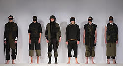 © Licensed to London News Pictures. 01/06/2015. London, UK. Collection by Al Mu. Fashion show of Nottingham Trent University at Graduate Fashion Week 2015. Graduate Fashion Week takes place from 30 May to 2 June 2015 at the Old Truman Brewery, Brick Lane. Photo credit : Bettina Strenske/LNP