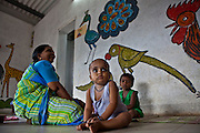Toddlers and a staff member at the Agripada Centre in Mumbai. The centre is 1 of 70 centres in India run by the Mumbai Mobile Crèche organisation.