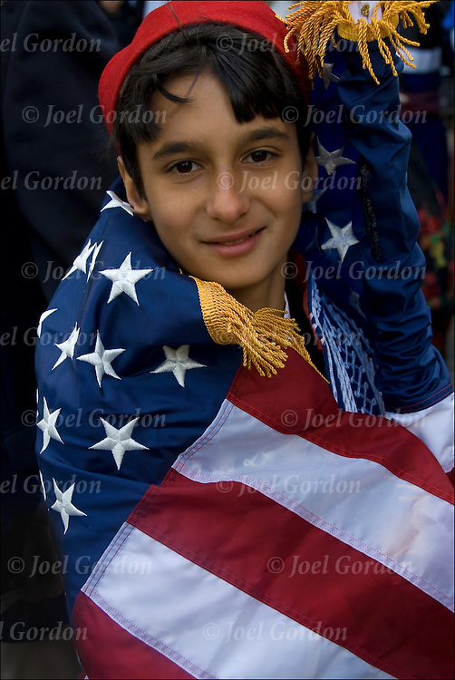 Greek American boy wear folk costume, wrapped in American Flag showing his ethnic pride and heritage in the Greek Independence Day Parade in New York City.