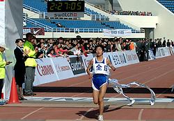 21-10-2007 ATLETIEK: ANA BEIJING MARATHON: BEIJING CHINA<br /> De Beijing Olympic Marathon Experience georganiseerd door NOC NSF en ATP is een groot succes geworden / Chen Rong CHI wint de marathon bij de vrouwen<br /> ©2007-WWW.FOTOHOOGENDOORN.NL
