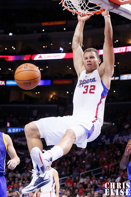 07 October 2014: Los Angeles Clippers forward Blake Griffin (32) goes for the dunk past Golden State Warriors guard Andre Iguodala (9) during the Golden State Warriors 112-94 victory over the Los Angeles Clipper, in preseason opener, at the Staples Center, Los Angeles, California, USA.