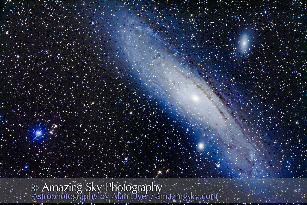 M31, the Andromeda Galaxy, with its companion galaxies, M32 (below) and M110 (aka NGC 205, above), framed to include the blue star Nu Andromedae at left, usually used as the star hopping guide star to find M31. <br /> <br /> This is a stack of 4 x 6 minute exposures with the Quattro 8 inch Newtonian reflector astrograph, using the Canon 5D MkII at ISO 800, taken from home.