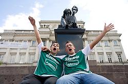 Slovenian fans having fun before sculpture of Mikolaj Kopernik  at Eurobasket 2009, on September 07, 2009 in Warsaw, Poland. (Photo by Vid Ponikvar / Sportida)