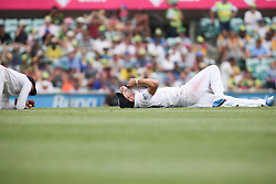 © Licensed to London News Pictures. 03/01/2014. James Anderson on the ground after dropping a catch  during the 5th Ashes Test Match between Australia Vs England at the SCG on 03 January, 2013 in Melbourne, Australia. Photo credit : Asanka Brendon Ratnayake/LNP