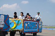 A plane tug pulling a carriage of passengers at the Komaki Airshow of the Japanese Air Self-Defense Force.