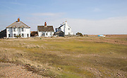 Seaside homes on the beach Shingle Street Suffolk