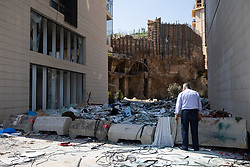 © Licensed to London News Pictures. 10/08/2020. Beirut, Lebanon. A man looks at debris near Downtown Beirut following an explosion in Beirut port on Tuesday 4 August. Photo credit : Tom Nicholson/LNP