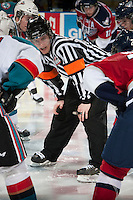 KELOWNA, CANADA - MARCH 22: Adam Griffiths, referee, lines up the face off between the Kelowna Rockets and the Tri-City Americans on March 22, 2014 at Prospera Place in Kelowna, British Columbia, Canada.   (Photo by Marissa Baecker/Shoot the Breeze)  *** Local Caption *** Adam Griffiths;