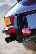 Image of a aubergine 1973 Porsche 911 RS/GT rear fender and exhaust pipe detail in Orange County, California, America west coast
