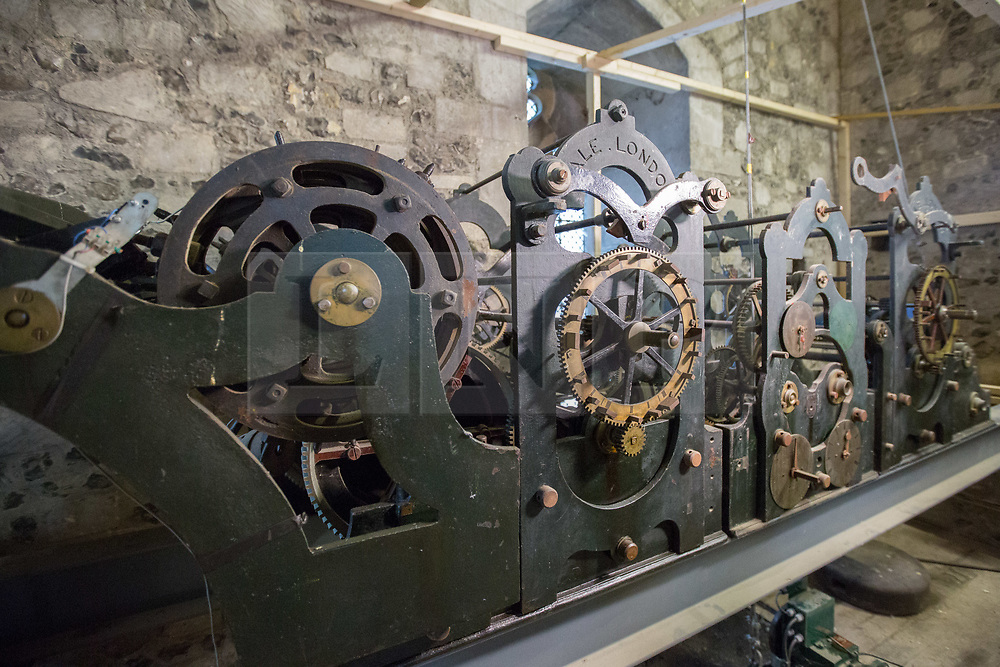 @Licensed to London News Pictures 27/11/2018.Canterbury, Kent. Canterbury clock mechanism removed for renovation. The Cathedral Clock and clock face built in 1855  and housed on the south west tower of Canterbury Cathedral is being dismantled ready to be renovated and re-guilded. The clock face weighing 78 kilos and measuring 8 feet in diameter is being shipped to the Cumbrai Clock Company in Penrith and will be absent from the cathedral for 18 months. Photo credit: Manu Palomeque/LNP
