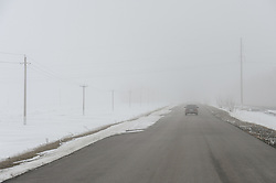 March 27, 2019 - Village Panov Bushes, Sampur Dis, Tambov region, Russia - The road in the fog. In the photo-the car rides on the road during the fog  (Credit Image: © Demian Stringer/ZUMA Wire)