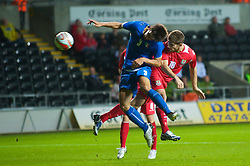SWANSEA, ENGLAND - Friday, September 4, 2009: Wales' Ched Evans sees his header go wide under pressure from Italy's Lorenzo Ariaudo during the UEFA Under 21 Championship Qualifying Group 3 match at the Liberty Stadium. (Photo by David Rawcliffe/Propaganda)