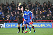 AFC Wimbledon midfielder Jake Reeves (8) yellow card during the EFL Sky Bet League 1 match between AFC Wimbledon and Walsall at the Cherry Red Records Stadium, Kingston, England on 25 February 2017. Photo by Matthew Redman.