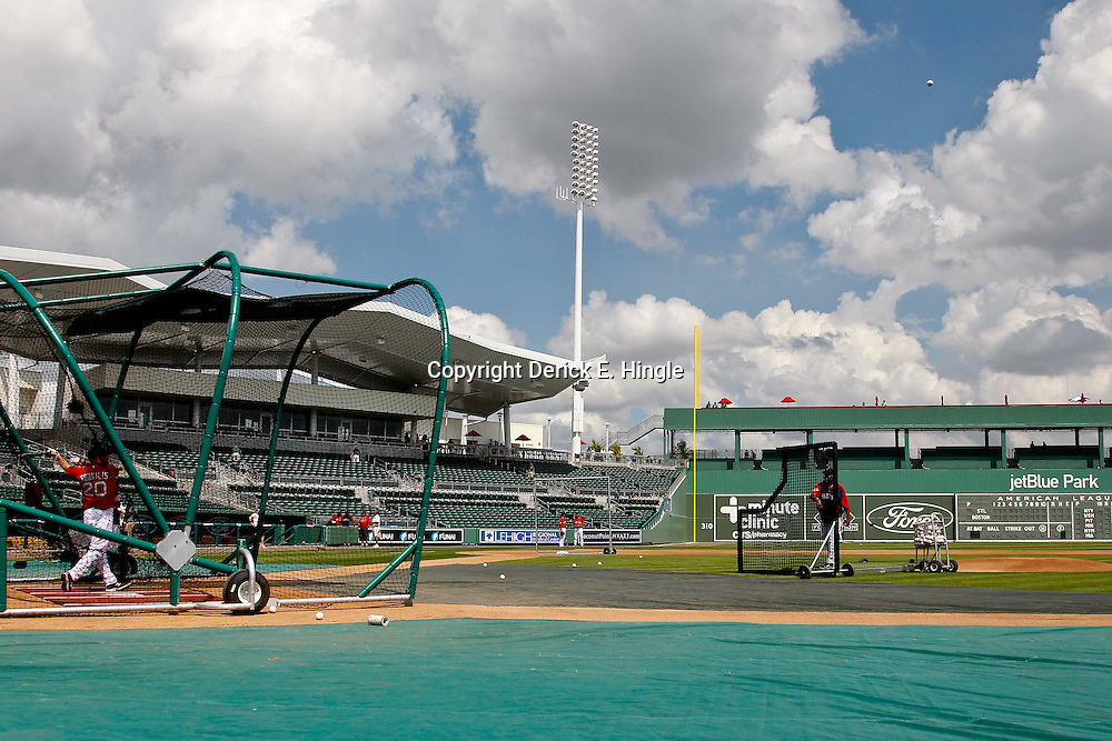 March 15, 2012; Fort Myers, FL, USA; Boston Red Sox third baseman Kevin Youkilis (20) hits a ball deep towards green monster in left field during batting practice before a spring training game against the St. Louis Cardinals at Jet Blue Park. Mandatory Credit: Derick E. Hingle-US PRESSWIRE