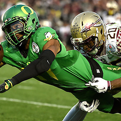 Oregon Ducks wide receiver Darren Carrington (87) dives for the touchdown past Florida State Seminoles defensive back Trey Marshall (20) in the second half of the 101st Rose Bowl game in Pasadena, California on Thursday, January 1, 2015. Oregon Ducks 59-20.