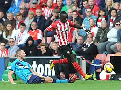 Southampton's Sadio Mane is tackled by Stoke's Phillip Bardsley - Photo mandatory by-line: Dougie Allward/JMP - Mobile: 07966 386802 - 25/10/2014 - SPORT - Football - Southampton - ST Mary's Stadium - Southampton v Stoke - Barclays Premier League