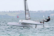Peter Burling (NZL275) finishes race three in second. A Class World championships regatta being sailed at Takapuna in Auckland. 12/2/2014