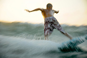 Israel, Mediterranean sea, Wave surfer as photographed from within the water. Model Release Available