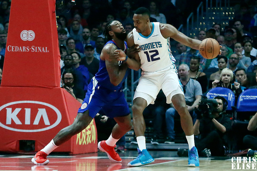 31 December 2017: Charlotte Hornets center Dwight Howard (12) posts up LA Clippers center DeAndre Jordan (6) during the LA Clippers 106-98 victory over the Charlotte Hornets, at the Staples Center, Los Angeles, California, USA.