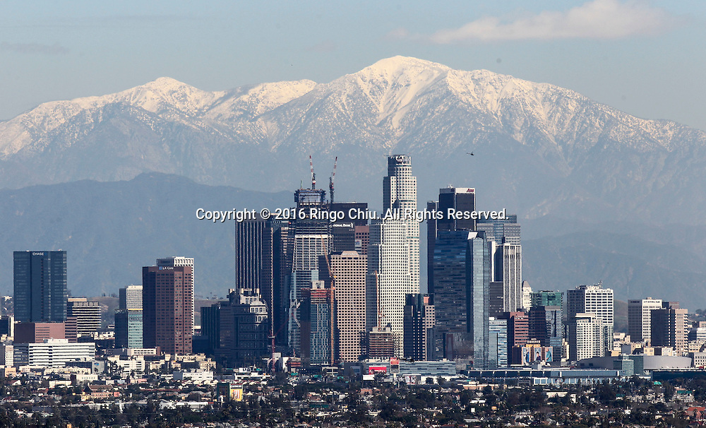 Snow covered the San Gabriel Mountains behind the Downtown Los Angeles skyline is seen at Kenneth Hahn State Recreation Area on Tuesday, Feb. 2, 2016. National Weather Service forecast sunny weather in most Southland communities today.  A slight warming trend will get underway Wednesday, leading to highs in the mid 70s Thursday and the high 70s by Sunday.(Photo by Ringo Chiu/PHOTOFORMULA.com)<br /> <br /> Usage Notes: This content is intended for editorial use only. For other uses, additional clearances may be required.