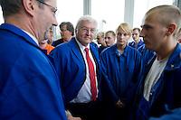 29 AUG 2008, EISENHUETTENSTADT/GERMANY:<br /> Frank-Walter Steinmeier (2.v.L.), SPD, Bundesaussenminister, und Matthias Platzeck (L), SPD, Ministerpraesident Brandenburg, im Gespraech mit Auszubildenden, waehrend dem Besuch des Stahlwerks ArcelorMittal Eisenhuettenstadt, der ehem. Eko Stahl, im Rahmen von Steinmeiers Sommerreise durch Brandenburg<br /> IMAGE: 20080829-01-039<br /> KEYWORDS: Eisenhüttenstadt, Blaumann